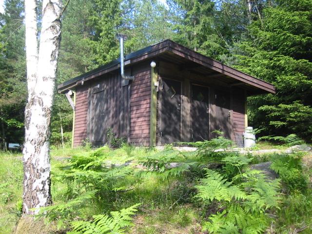 Toalettbyggnad.